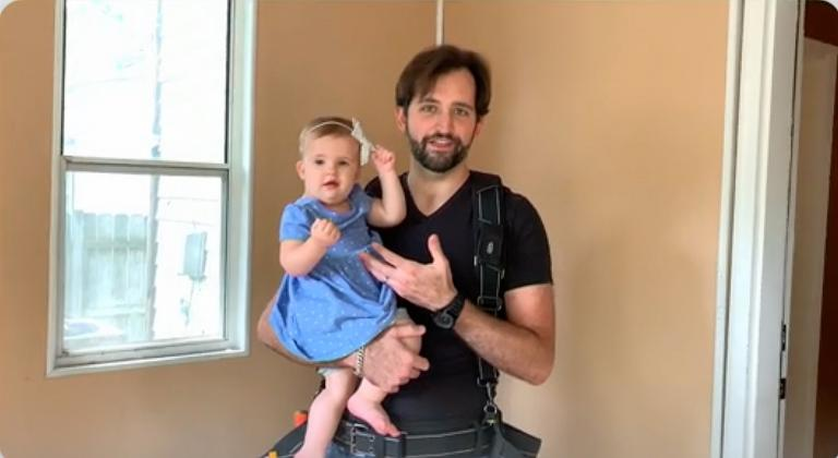 Scientology parent Alex, at home with his daughter Vivienne.