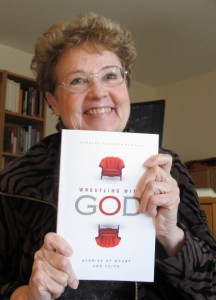 Barbara Falconer Newhall in her writing studio with a copy of her book, Wrestling with God. cover design by Michelle Lenger. Photo by Barbara Newhall