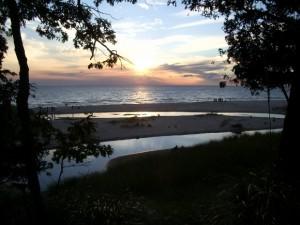 Lake Michigan sunset along a sandy beach. Photo by Barbara Newhall