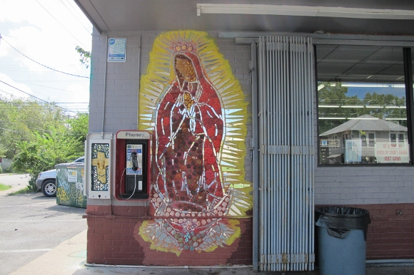 A figure of the Virgin of Guadalupe decorated an exterior of a check cashing establishment in Austin, TX. Photo by Barbara Newhall