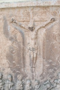 This stone Jesus crucified is embedded in the wall of the parish church in Melk, Austria. Photo by Barbara Newhall