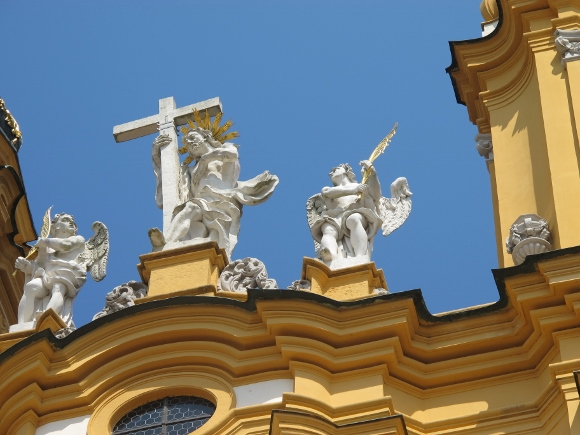 At the Abbey at Melk,  Austria, a statue of the risen Christ, rather than a crucifix, with a cross stands over the entrance to this s Benedictine monastery . The figure represents victory of life over death. Unlike its gothic and renaissance