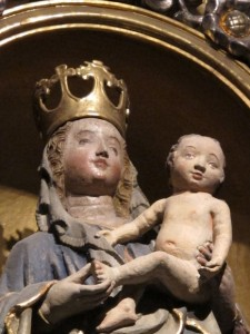 A statue of the Virgin Mary with infant Jesus stands in Annunciation Altar of the Regensburg Cathedral.  photo by Barbara Newhall
