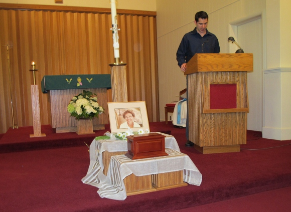 Peter Newhall reads from scripture at the memorial service for his grandmother Catherine Falconer at St. Vincent Catholic Church, Pentwater, Michigan. Photo by Barbara Newhall