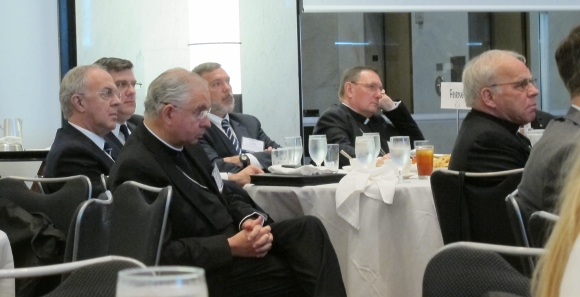 A score of Catholic clergy dressed in black participated in the Religion Newswriters Association  conference in Philadelphia on August 28, 2015. Photo by Barbara Newhall