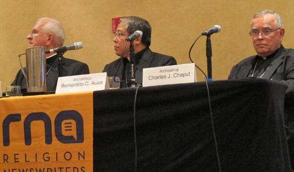 Archbishops Joseph E. Kurtz, Bernardito C. Auza and Charles J. Chaput at the meeting of the Religion Newswriters Association in Philadelphia last week. Photo by Barbara Newhall