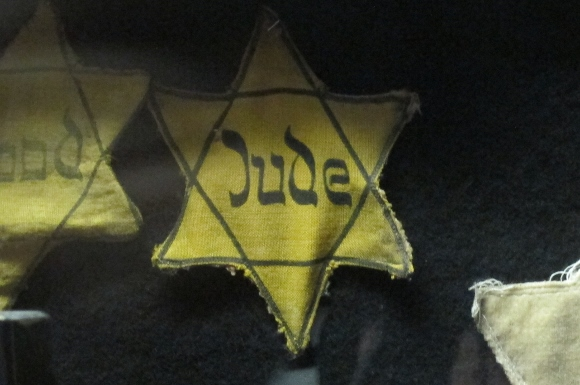 """Two Stars of David, one with the German word """"Jude"""" (Jew) in old script -- from Nazi era Germany. At the Dohany Street Synagogue, Budapest. Photo by Barbara Newhall"""
