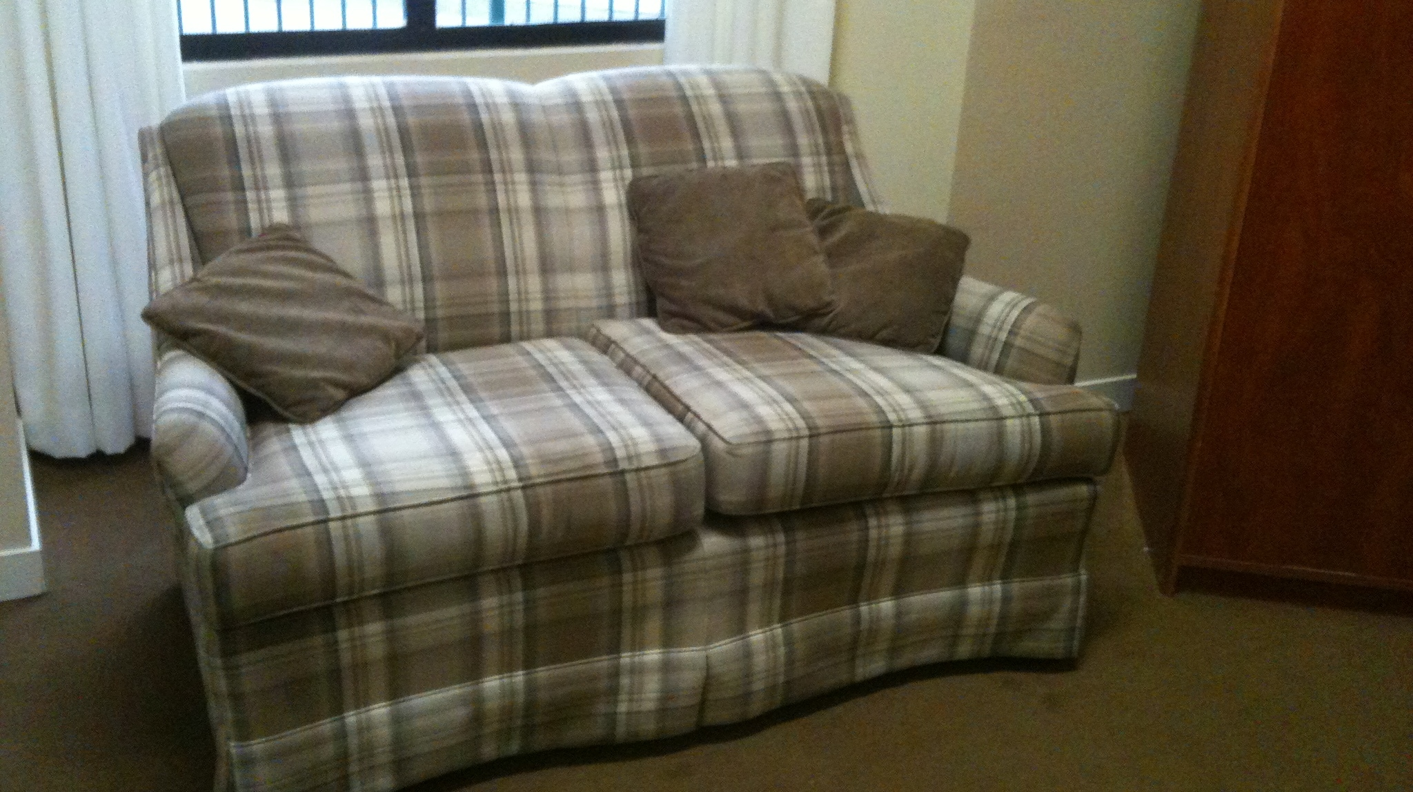 A plaid love seat owned by Barbara Falconer Newhall's mother. My Mother's Stuff. Photo by Barbara Newhall
