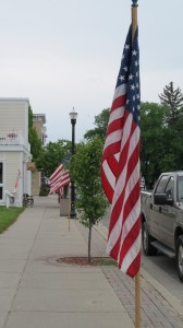 The American flag flies on a main street in the Midwest. Give last-minute gifts of patriotism. Photo by Barbara Newhall