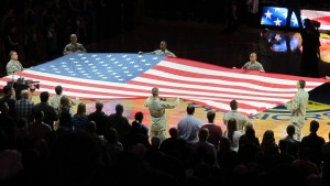 The American flag is displayed at a Warriors basketball game in Oakland, CA. Last-minute gifts. Photo by Barbara Newhall