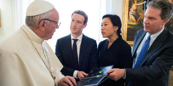 Pope Francis meets with Mark Zuckerberg and Priscilla Chan in his residence at the Vatican. The man at right is not identified. (Pool)