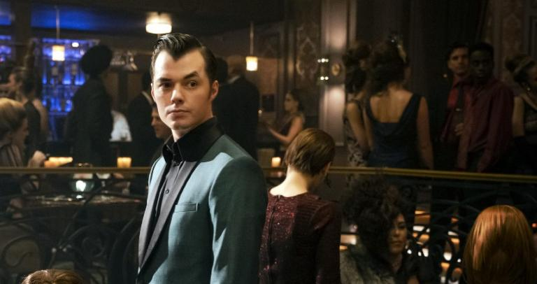 Alfred Pennyworth (Jack Bannon) stands in his nightclub.