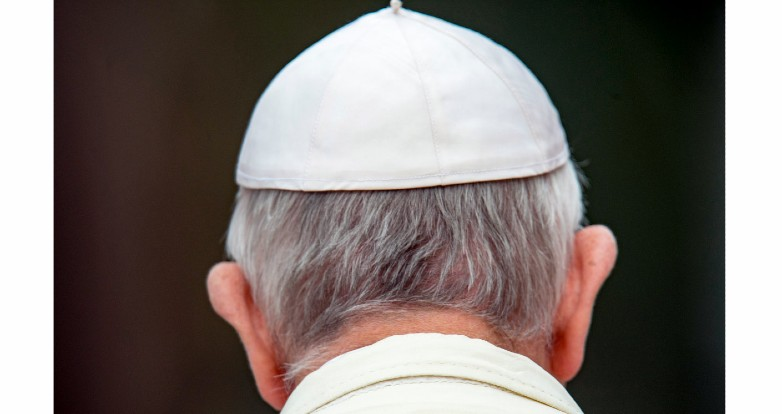 The head of Pope Francis, seen from the back.