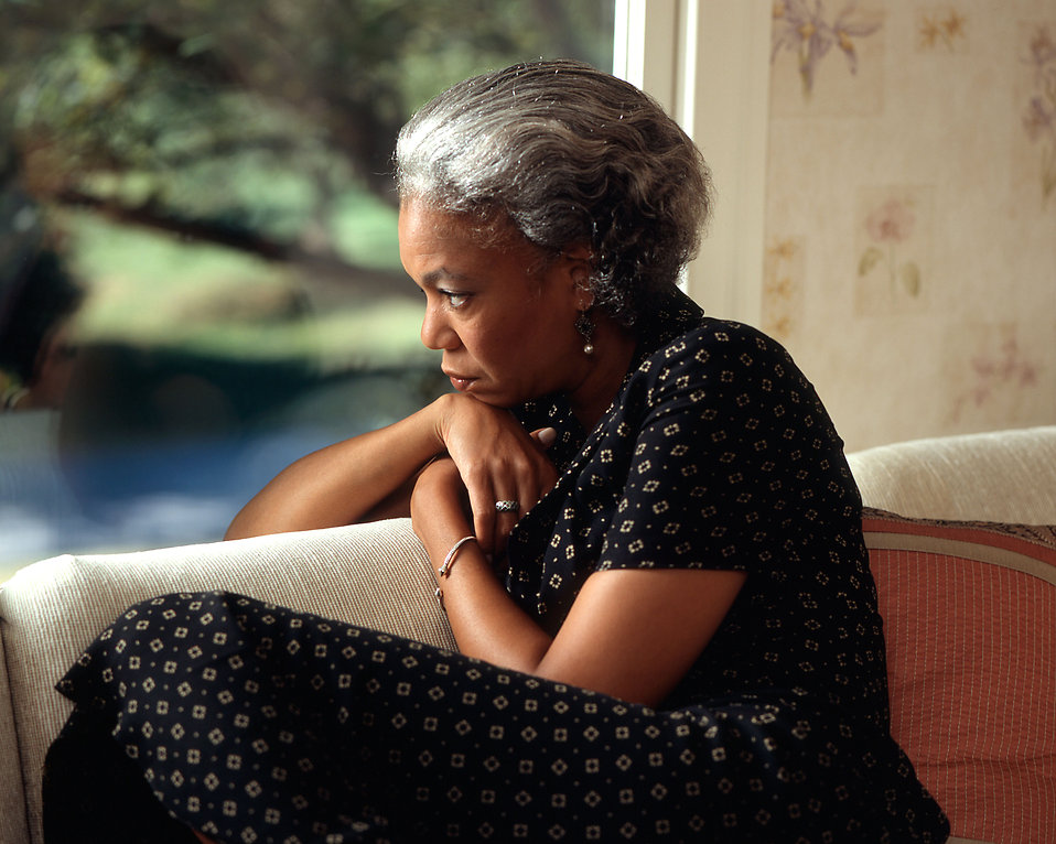 17074-an-african-american-woman-looking-out-a-window-pv
