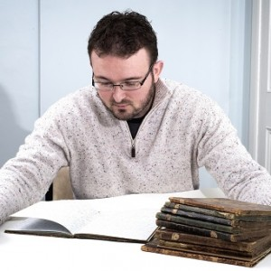 Christian George with some of Spurgeon's lost notebooks.