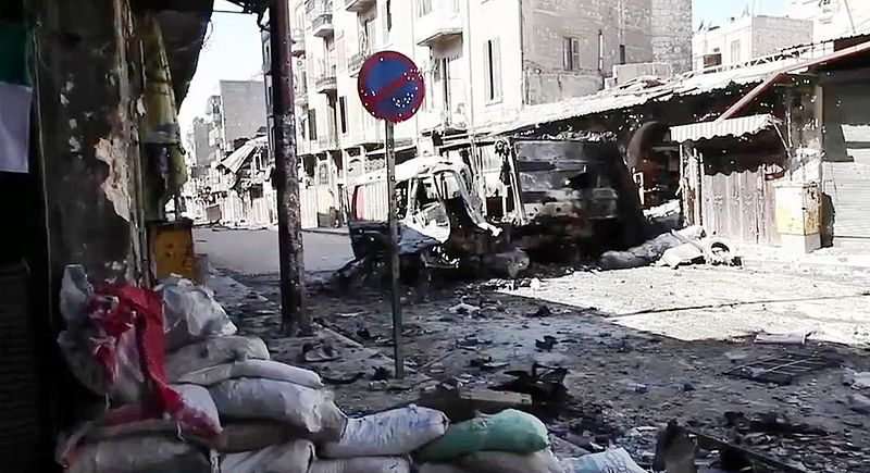 https://commons.wikimedia.org/wiki/File%3ABombed_out_vehicles_Aleppo.jpg; By Voice of America News: Scott Bobb reports from Aleppo, Syria [Public domain], via Wikimedia Commons