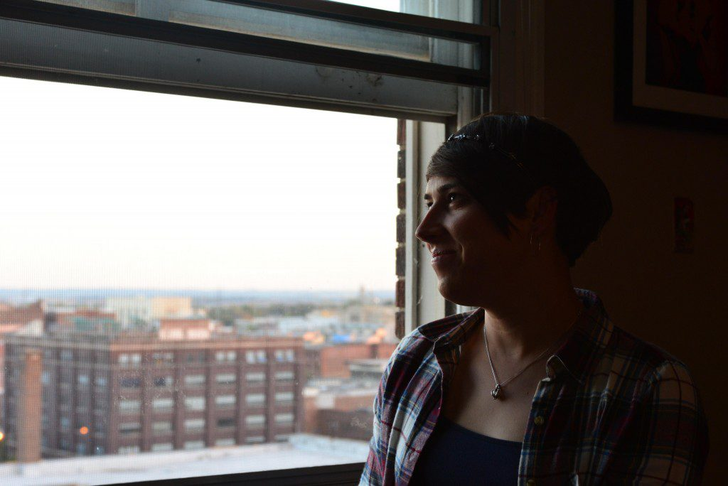 Staff Sgt. Ashleigh Buch, an instructor with the 338th Combat Training Squadron at Offutt Air Force Base, Neb., looks out over the city of Omaha from her apartment Oct. 20, 2016. Buch is the first openly serving transgender Airman to be recommended for a return to flying duties. (U.S. Air Force photo/Senior Airman Rachel Hammes) ; http://www.offutt.af.mil/News/Features/Display/Article/998356/transgender-airman-flies-high-with-new-af-policy/