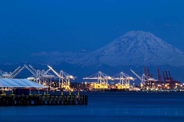 Photo of the port lit up at night with Mt. Rainier in the background
