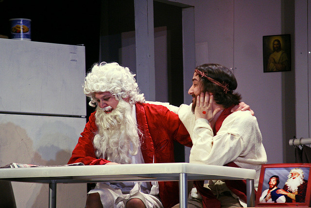 "A mythical character comforts his partner. (Credit: Steven Depolo, ""Gay Jesus Musical 12-18-09 13"", CC license.)"