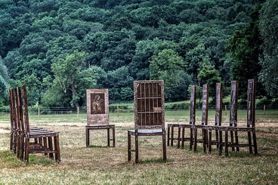 """The Jurors."" (WyrdLight.com, CC BY-SA 4.0.) A sculpture at Runnymede. Each chair bears images of past struggles for human rights and freedoms. The grid on the front chair represents the bars of Nelson Mandela's prison cell. It's hard for me to look at this piece without feeling a wild surge of hope in our species, that we'll do the right thing... eventually."