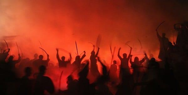 swordsmen and warriors in red cloudy lighting