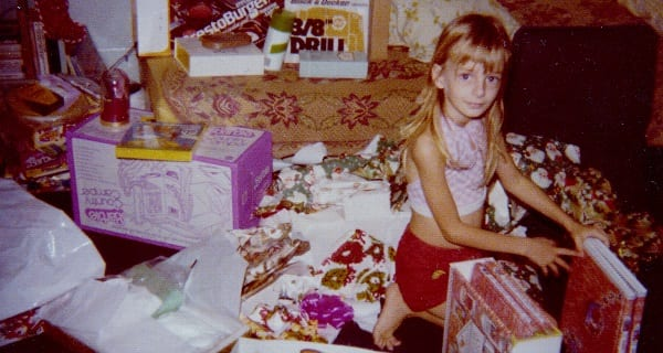 little cas as a kid with her christmas presents
