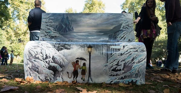 a bench painted with imagery from Narnia
