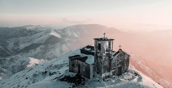 very old church atop a snowy hill