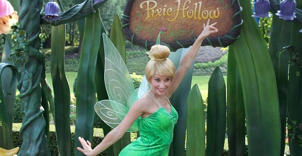 "tinker bell posing in front of a sign reading ""Pixie Hollow"""