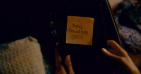 a post-it note on a book: mom I hope this helps