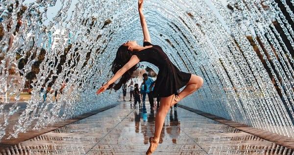 a woman striking a ballet pose