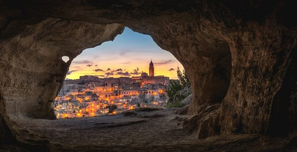 looking out from a cave into a gorgeous city