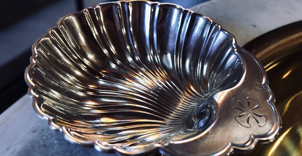 a silver baptismal shell