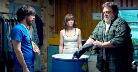 "Emmett and Michelle, wary of Howard's schemes, in ""!0 Cloverfield Lane"""