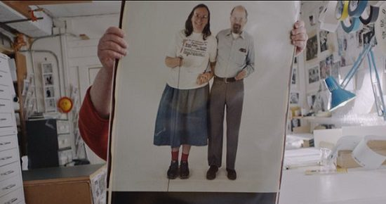 """Elsa Dorfman, holding up a portrait of herself with Allan Ginsberg, in """"The B-Side"""""""