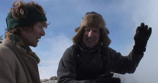 Clive Oppenheimer and Werner Herzog chatting on the side of Mount Erebus in Antarctica