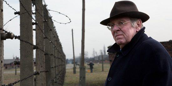 "Richard Rampton (Tom Wilkinson), visiting Auschwitz in ""Denial"""