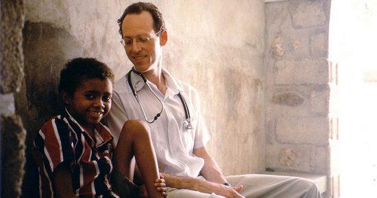 "Paul Farmer with a Haitian friend, in ""Bending the Arc"""