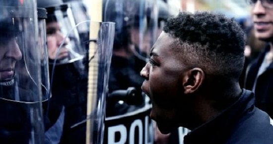 "A showdown between a Ferguson protester and a militarized police force, as seen in ""I Am Not Your Negro"""
