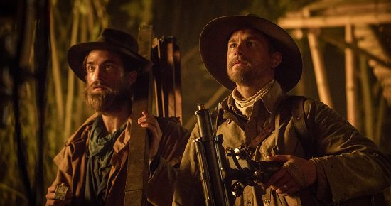 """Robert Pattinson and Charlie Hunnam, as Henry Costin and Percy Fawcett, in """"The Lost City of Z"""""""