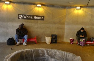 For use with Inequality-WashingtonDC/ special report Homeless men hang around the entrance to the Metro close to the White House early Christmas morning in Washington, in this December 25, 2011 file photo. REUTERS/Larry Downing (UNITED STATES)