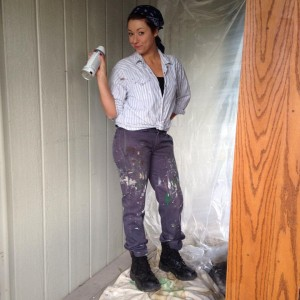 HI! That is me, in my husband's clothes preparing to spray paint a book shelf.