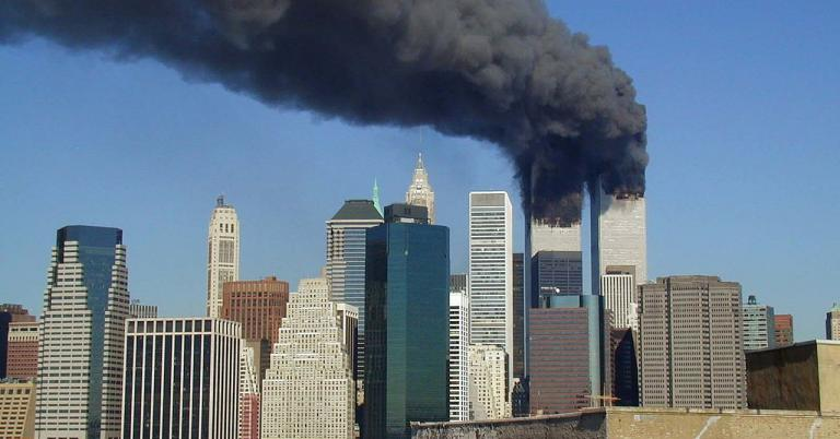 Plumes of smoke billow from the World Trade Center towers