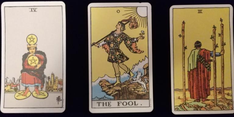 a Tarot reading: 4 Pentacles, The Fool, 3 Wands