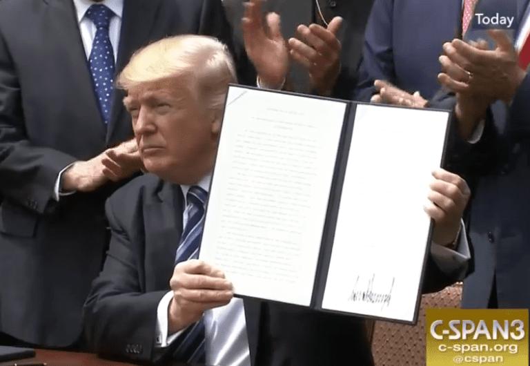 "Trump signs his executive order on ""religious liberty,"" screenshot via CSPAN."