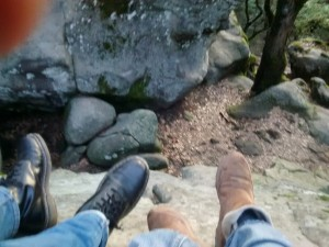 My phone slipped when I tried to take a selfie. Now I actually have an unintended picture of our feet dangling from the rock. I didn't know I had this picture when I wrote about this moment.