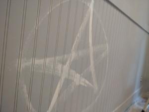 A devoking pentacle, white on primer.