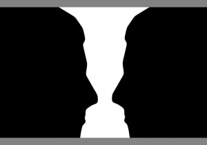 Two_silhouette_profile_or_a_white_vase