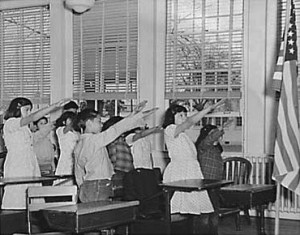 Students_pledging_allegiance_to_the_American_flag_with_the_Bellamy_salute-300x235