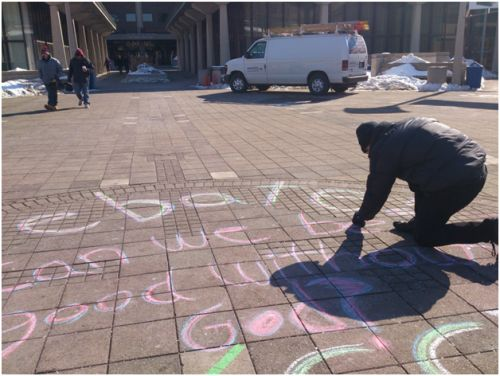 Matt chalking before the debate in our school's quad.